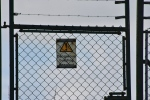 security fence and sign